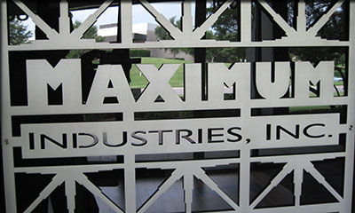 "Maximum Industries - 1/4"" aluminum--abrasive waterjet cut grill in lobby of Maximum Industries"